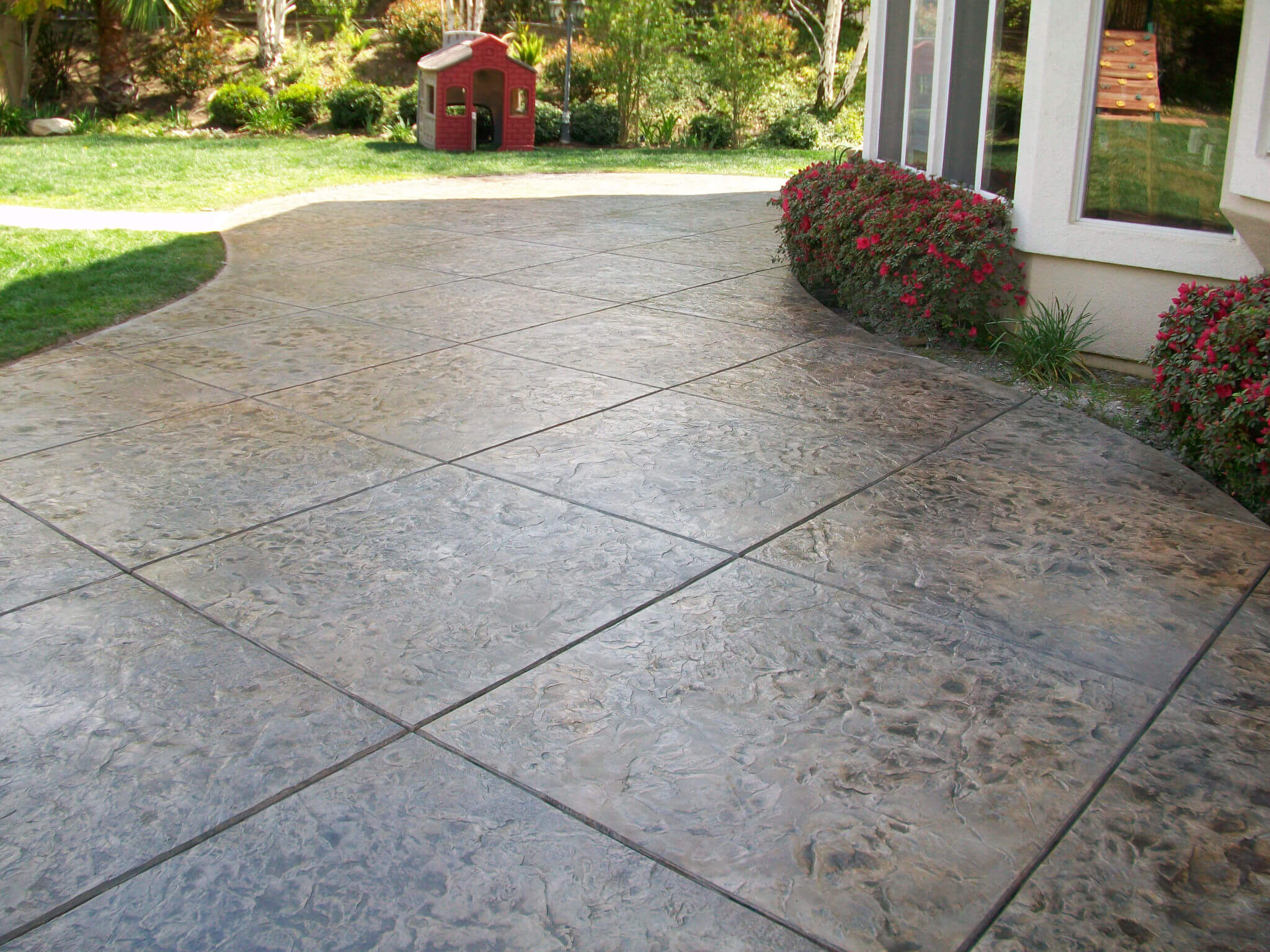 Stamped Concrete Vs Interlocking Stone Adams Landscape